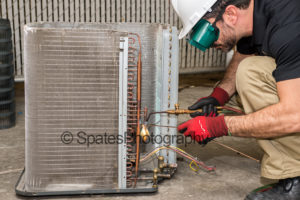 HVAC training brazing copper pipe on condensing unit