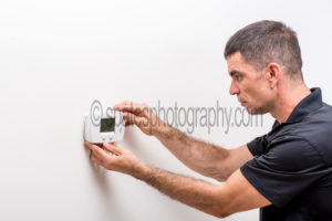 Honeywell FocusPro 5000 thermostat installation of the face cover