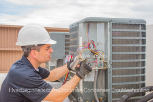 Dave Spates HVAC Technician removing wires from a run capacitor
