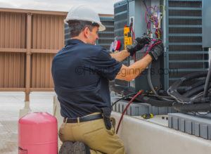 On the job hvac training, technician checking voltage at condensing unit