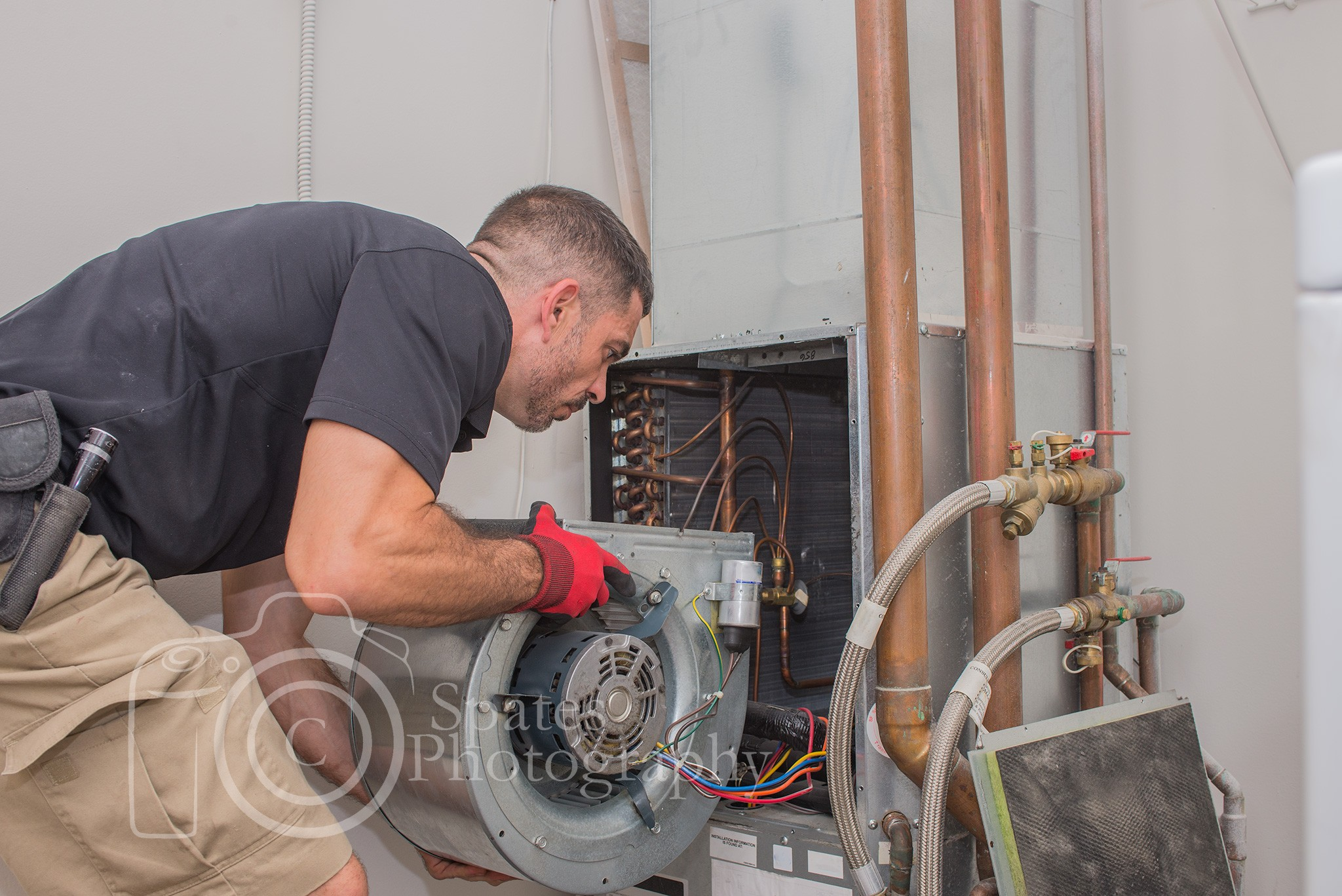Hvac training guide to a successful career path hvac technician installing blower motor in a commercial heat pump xflitez Choice Image