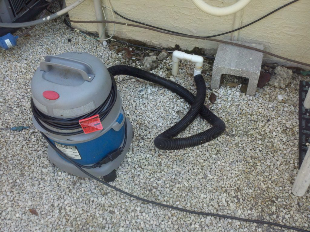 Cleaning a condensate drain line with a wet vacuum